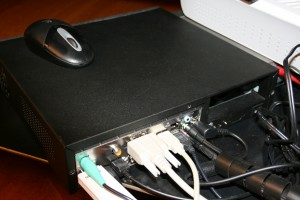 The back of the case showing the multitude of connections: PS/2 mouse, USB Wi-Fi Siemens stick, optical S/PDIF output, HDMI, VGA, analog audio out and the DC power cable (the brick is out of view)